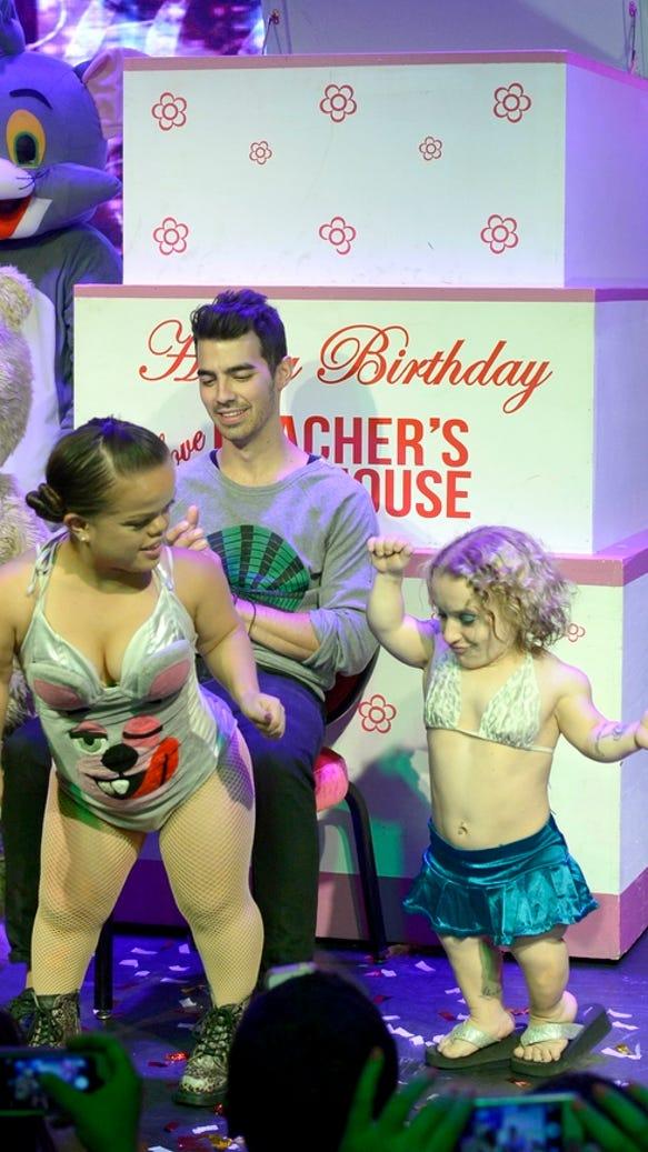 Joe Jonas with World%27s Smallest Stripper and Mini Miley Stripper