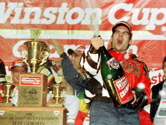 Jeff Gordon sprays champagne after winning the 1998