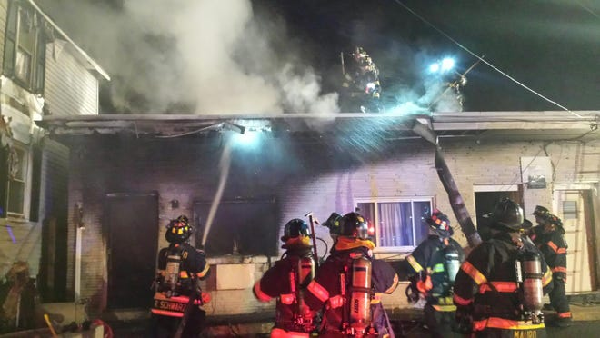 Fire fighters from the Asbury Park Fire Department put out flames at a Springwood Avenue apartment complex. Five residents were displaced by the late night into early morning blaze.