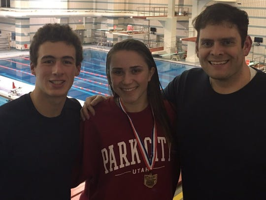 State qualifying divers Noah Vigran, left, and Annie Garretson also sing for Indian Hill choir director Jeff Clark. State qualifying divers Noah Vigran, left, and Annie Garretson also sing for Indian Hill choir director Jeff Clark.