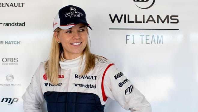 FILE - Susie Wolff will take part in the first practice session ahead of both the British and German Grands Prix as part of her expanded development driver role with Williams. Wolff will take to the track at Silverstone ahead of the British GP in July, having made her full F1 test debut at the circuit last July.