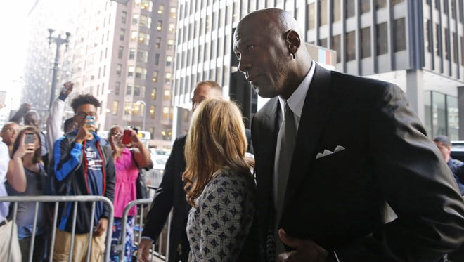 Basketball Hall of Famer Michael Jordan arrives at the federal courthouse in Chicago, Tuesday, Aug. 18, 2015. Jordan took the stand in his case against a now-defunct grocery store chain that used his image without permission.