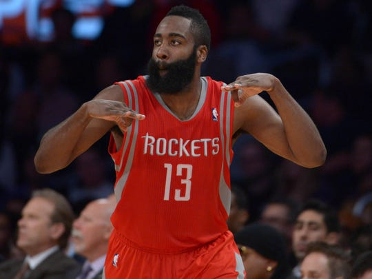 Houston Rockets guard James Harden (13) celebrates after a 3-point basket against the Los Angeles Lakers.