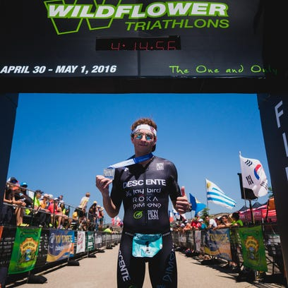 Oregon triathlete Jesse Thomas poses with his medal after winning the Wildflower Triathlon this past weekend at Lake San Antonio. It is Thomas' sixth consecutive championship.