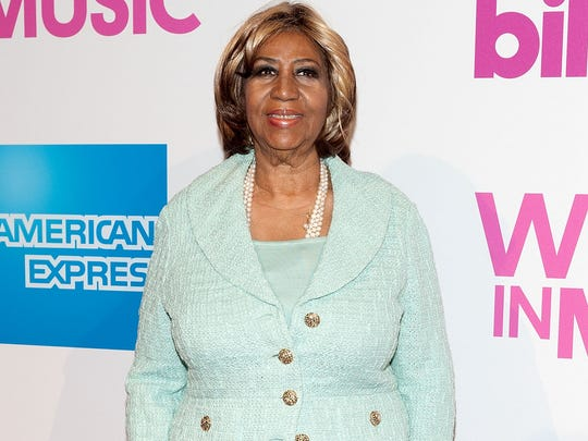 Aretha Franklin attends the 2014 Billboard Women In