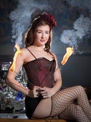 Sadie Blaze (Jama Jenkins) practices her fire-eating
