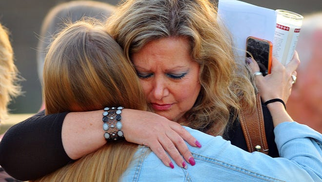 Hundreds of family and friends mourn the loss of Christopher, PJ and Laci, the three children who were killed by mother Jessica McCarty on Friday night at their Palm Bay home. A  prayer vigil was held at Palm Bay Christian Church on Monday evening.