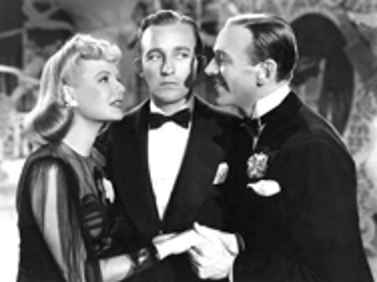 Marjorie Reynolds, Bing Crosby and Fred Astaire star