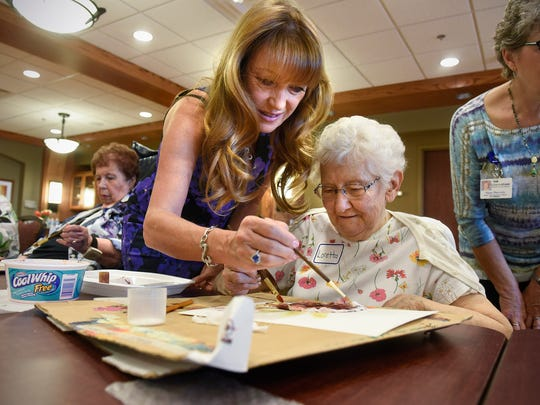 """Jane Seymour works with seniors during an art class at St. Benedict's Senior Community Friday, May 5, in St. Cloud. Seymore is best known for her work in the television series """"Dr. Quinn, Medicine Woman."""""""