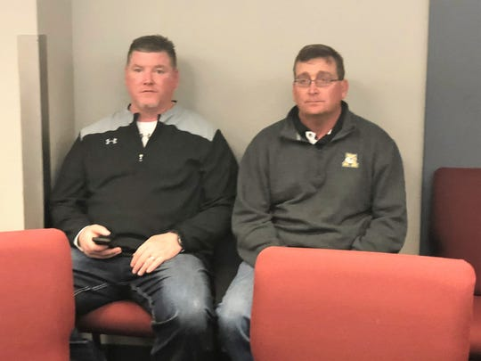 Abilene High head coach Del Van Cox, right, and assistant