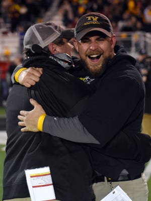 Former Tri-Valley coach Justin Buttermore, left, and assistant Cameron West celebrate seconds after Tri-Valley's 24-6 win against Akron St. Vincent-St. Mary in the 2017 state semifinals. West was selected as the Scotties' new head coach, pending board approval.