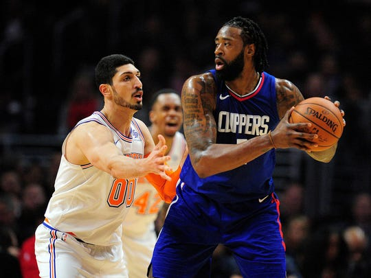 Los Angeles Clippers center DeAndre Jordan (6) controls the ball against New York Knicks center Enes Kanter (00) during the first half at Staples Center.