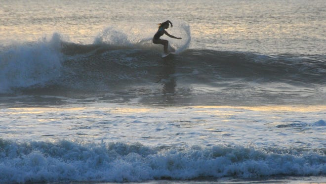 The surf along the Brevard County coastline will continue to be high through the week and into the weekend, according to meteorologist Scott Kelly with the National Weather Service in Melbourne. Surfers were out at dawn at the Cocoa Beach Pier taking advantage of the waves.