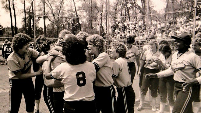 Whiteford celebrates winning the Class D state softball championship in 1984.