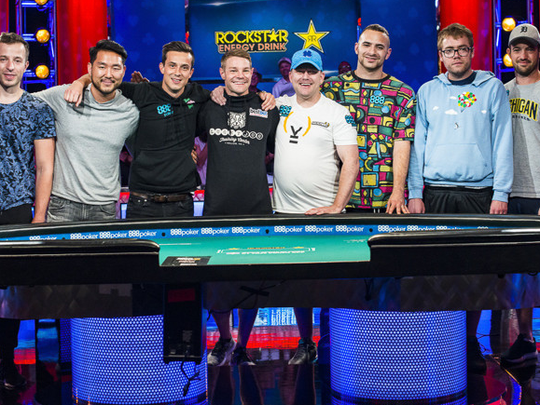 Nic Manion, center with blue hat, poses with the other members of the WSOP Main Event final table.