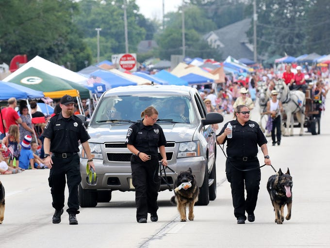 Milwaukee K9 officers and their and handlers march