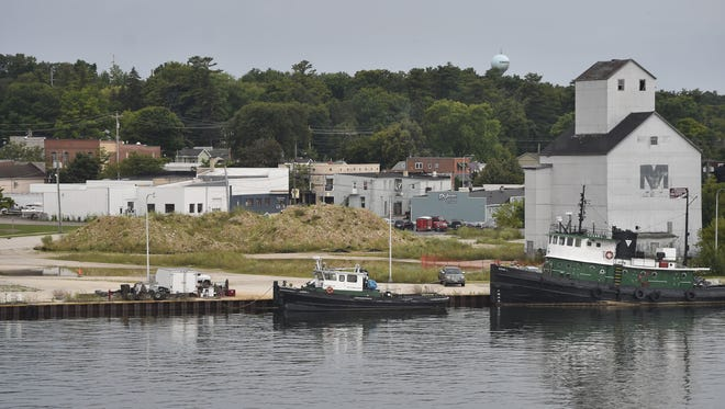 View of the embattled waterfront and granary, right, along the Sturgeon Bay Canal on the city's west side on Aug. 6, 2017.