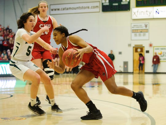 CVU's Mekkena Boyd (3) drives to the hoop past St. Johnsbury's Sadie Stetson (5) during the Vermont high school girls division I basketball championship between the St. Johnsbury Hilltoppers and the Champlain Valley Union Redhawks at Patrick Gym on Sunday afternoon March 11, 2018 in Burlington.