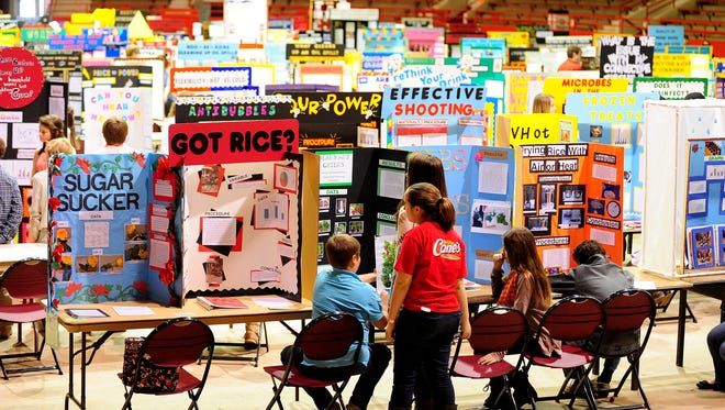 Students await judging during the Louisiana Region IV Science and Engineering Fair at the Blackham Coliseum in Lafayette, LA, February 15, 2014.   By Paul Kieu, The Advertiser February 15, 2014