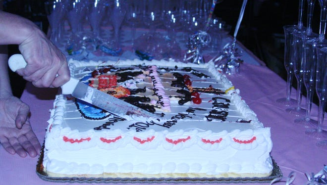 The first anniversary cake for Pioneer Crossing Casino is cut during last Saturday's one-year anniversary for Pioneer Crossing in Yerington.