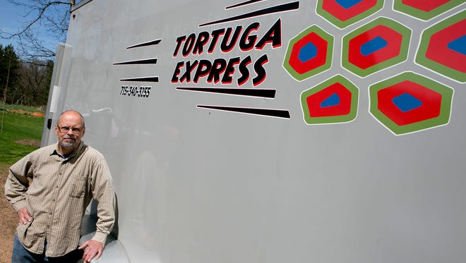Alec Linde of Custer poses next to his food truck, the Tortuga Express at his home, Monday, May 4, 2015. S