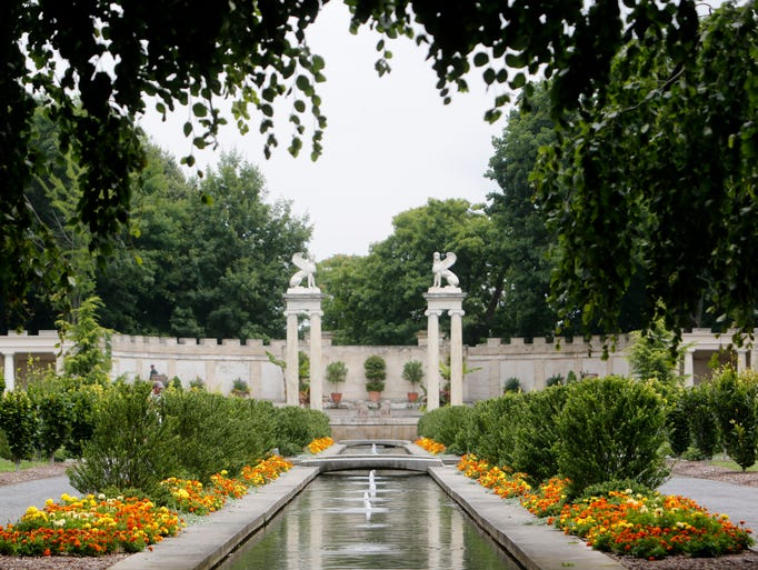 Marigolds are in bloom along the water channels of the walled garden at Untermyer Park, July 15, 2014 in Yonkers.