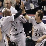 Willie Harris, left, is congratulated by Aaron Rowand after scoring the winning run for the Chicago White Sox in Game 4 of the 2005 World Series against Houston.