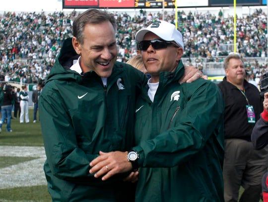 Mark Dantonio, left, and Don Treadwell celebrate Michigan