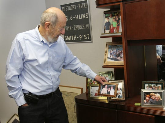 Steve Russell, former chairman and CEO of Celadon, shows family photos in his office on Dec. 13, 2010.