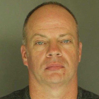 York City Police Officer Ritchie Page Blymire, charged