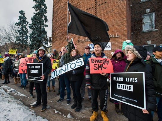 Several hundred demonstrators marched across the campus of St. Michael's College in Colchester on Friday, December 8, 2016, to protest the treatment of people of color.