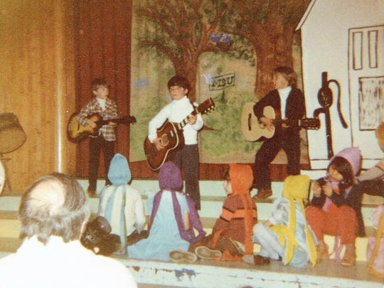 """Shawn Moore, far right, is channeling The Beatles in this photograph taken during a performance of """"Lucy in the Sky with Diamonds"""" at Hawkins Elementary School. Shawn was 13 when he was kidnapped and killed in 1985."""
