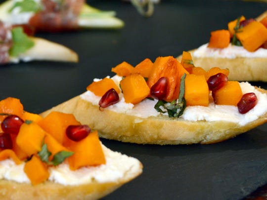Butternut Squash and Pomegranate Crostini add bright colors to the buffet.