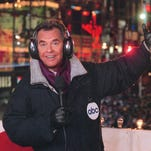 """Dick Clark is seen surrounded by fans during a television broadcast of """"American Bandstand."""" Clark, the television host who helped bring rock `n' roll into the mainstream, died Wednesday, April 18, 2012 of a heart attack. He was 82."""