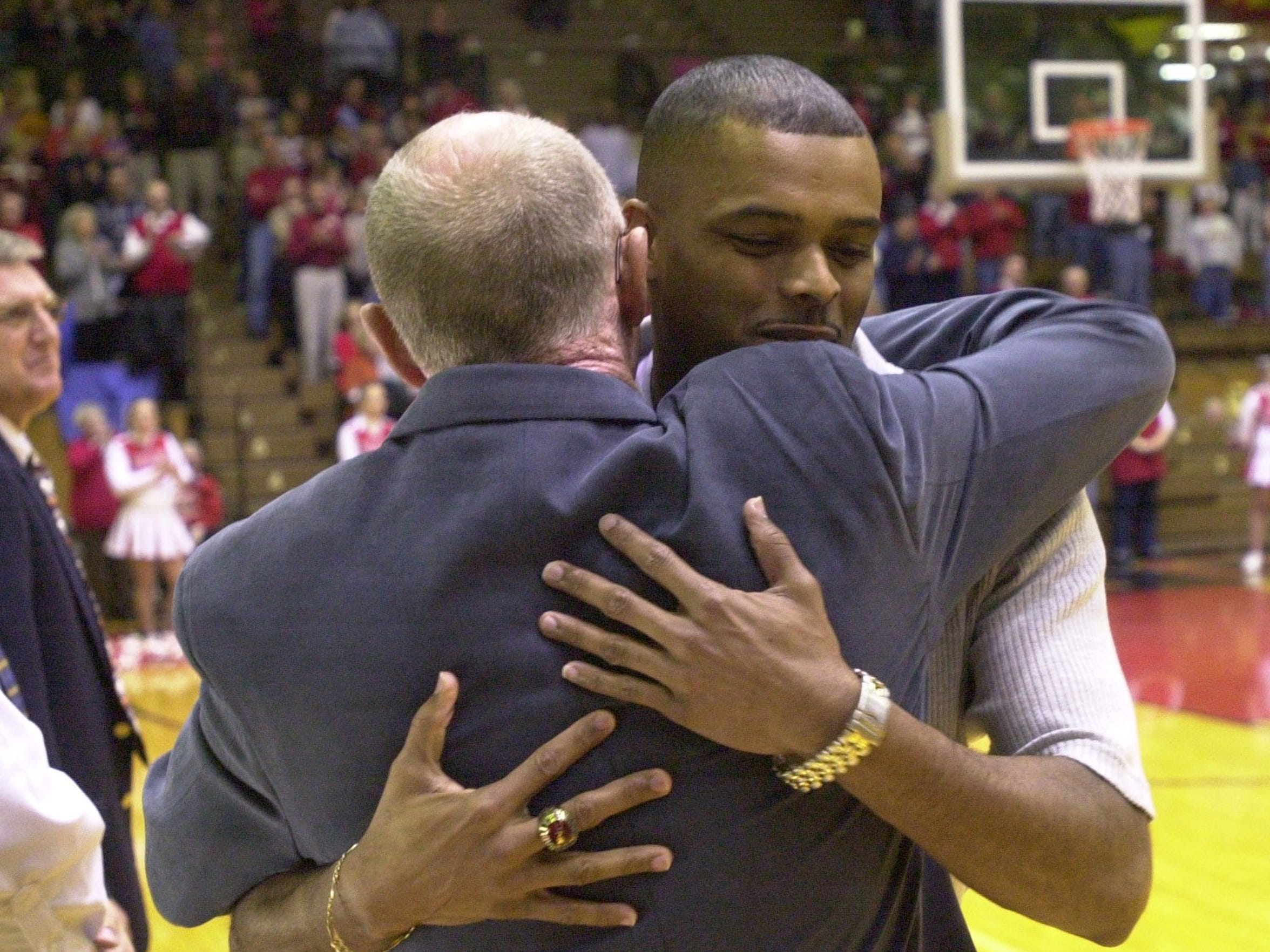 Former Richmond High School basketball player Billy Wright hugs coach George Griffith during introductions at the Tiernan Center in Richmond Saturday night, Jan. 26, 2002.