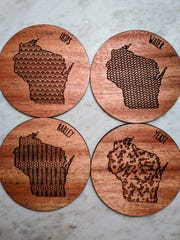 A coaster set from Milwaukee Beer Gear etched with a map of the state and the main ingredients for its most famous beverage.