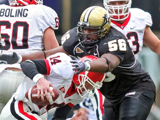 Vanderbilt defensive tackle Greg Billinger (56) sacks Georgia quarterback Joe Cox during the second quarter in Nashville, Tenn., Saturday, Oct. 17, 2009.