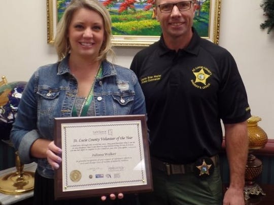 Juliana Walker and Capt. Brian Hester. Walker of the St. Lucie County Sheriff's Office was the St. Lucie County Volunteer of the Year.
