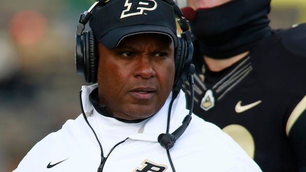 FILE - In this Saturday, Nov. 23, 2013 file photo, Purdue head coach Darrell Hazell watches his team play against Illinois in the second half of an NCAA college football game in West Lafayette, Ind. The Minnesota Vikings have hired former Purdue head coach Darrell Hazell as their wide receivers coach. Hazell's deal was finalized Thursday, Feb. 23, 2017 along with the staff for 2017 under head coach Mike Zimmer. (AP Photo/R Brent Smith, File)