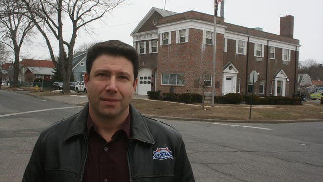 Fairview volunteer firefighter David Hecht, who won a $250,000 award from the Fairview Fire Department in an age-discrimation lawsuit, stands by headquarters on Rosemont Boulevard in Greenburgh.