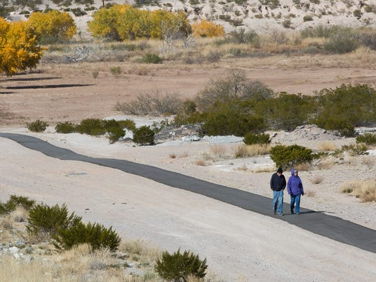 Roger and Denise Forand walk the newly built Las Cruces
