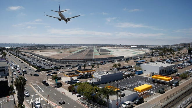 The perimeter of San Diego International Airport on May 13, 2016, shows part of its security consisting of multiple fences with a combination of razor wire and barbed wire, in San Diego.