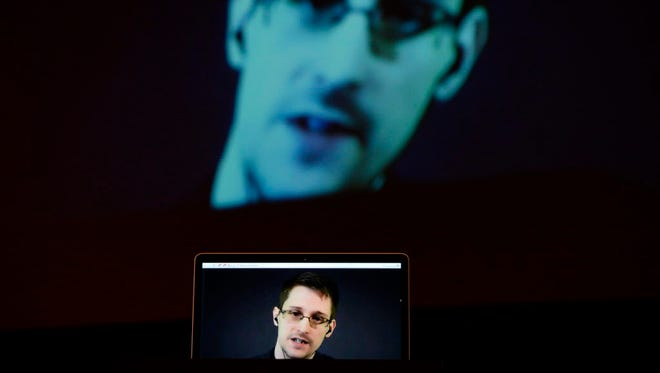 Edward Snowden appears from Russia to people inStuttgart, Germany, in 2014.