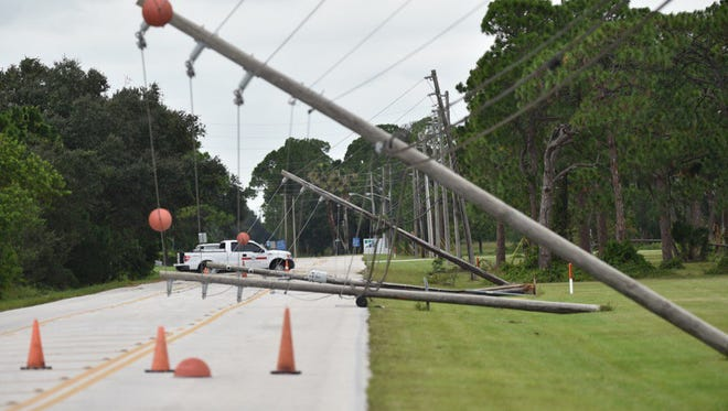 Downed power lines from Hurricane Matthew were seen along St. Lucie Boulevard in Fort Pierce on Friday, Oct. 7, 2016.