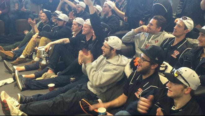 RIT men's hockey players burst into cheers Sunday as the NCAA announces they will play top-ranked Minnesota State-Mankato in the first round of the Division I men's hockey championship playoffs.