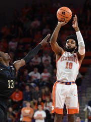 Clemson guard Gabe DeVoe (10) shoots over Pitt guard Khameron Davis (13) during the 2nd half on Thursday, February 8,  2018 at Clemson's Littlejohn Coliseum.