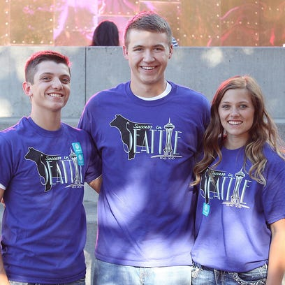 "These junior Angus members represented South Dakota at the 2015 LEAD (Leaders Engaged in Angus Development) Conference, Aug. 6-9 in Seattle, Wash. Pictured from left are Tyler Bush, of Britton, Alex Rogen, of Brandon, and Madison Styles, Brentford. A total of 136 juniors from 29 states and Canada attended the conference, ""Success in Seattle,"" where they enhance leadership and interpersonal skills while learning more about the beef industry."