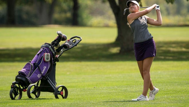 Central's Sarah Hale takes another swing during a hole Sept. 16 at Crestview Golf Course during the Delaware County Girls Golf Sectional.