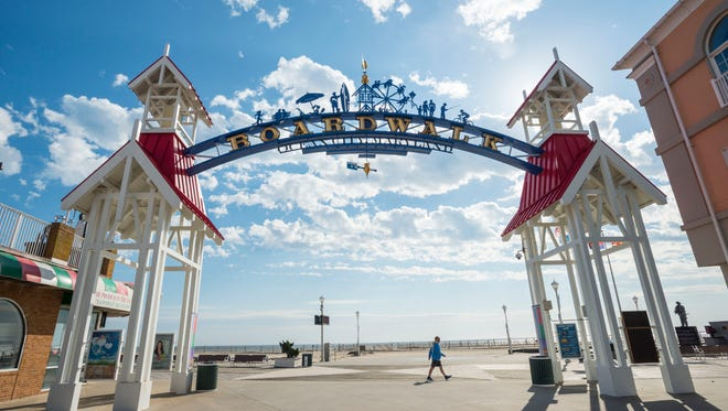 A walker makes his way past the OC Boardwalk Arch near North Division Street in Ocean City.
