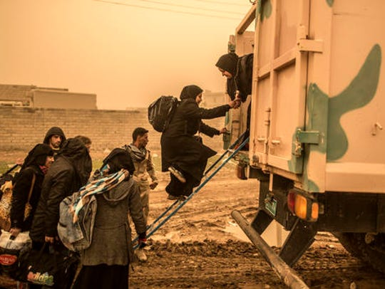 Civilians get into a military truck while trying to